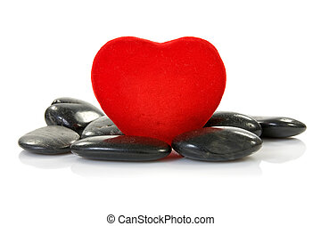 red heart with black stones