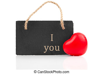 red heart with blackboard, on white wooden background