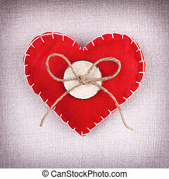 Red heart with button and bow