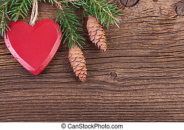 Red Heart with Fir Branch on a Wooden Background