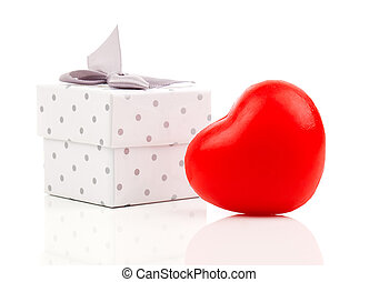 red heart with gift box, on white wooden background
