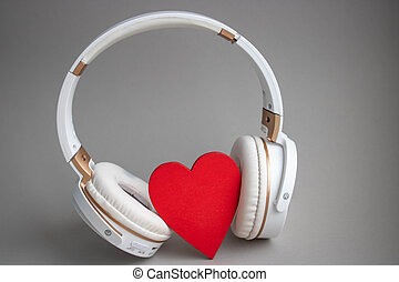 red heart with headphones on gray background. valentines day concept
