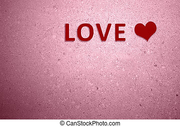 Red heart with LOVE text on the pink wall background