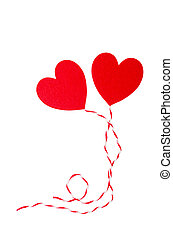 Red heart with rope isolated on white.
