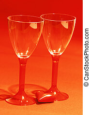 Red heart with two shiny wine glasses