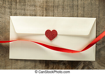 Red hearts and white envelope