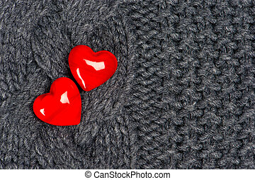 red hearts of knitted wool