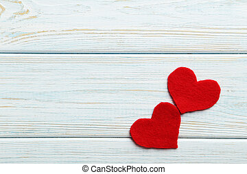 Red hearts on a blue wooden table