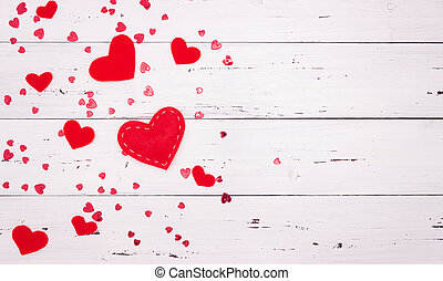 Red hearts on a white wooden background. Top view, free space for text. valentine's day, love.