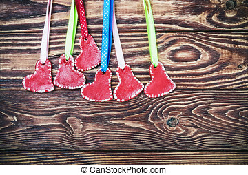 red hearts on a wooden