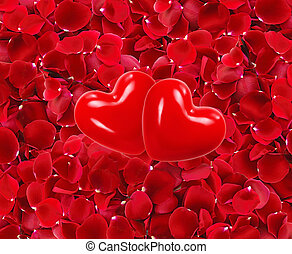 red hearts on beautiful red rose petals background