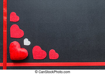 Red hearts on black chalkboard.