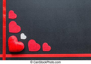 Red hearts on black chalkboard.