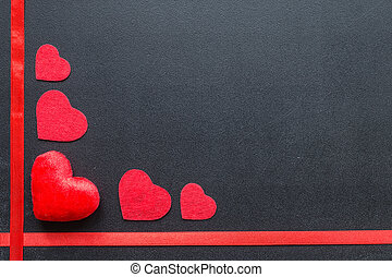 Red hearts on black chalkboard