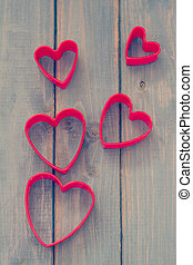 red hearts on blue wooden background