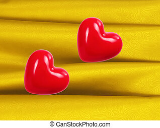 Red hearts on fabric background