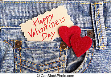 Red hearts on jeans pocket.