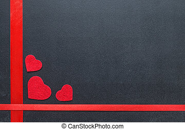 Red hearts on the chalkboard