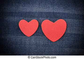 Red hearts on the jeans.