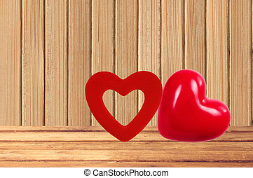 Red hearts on the wooden background