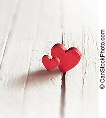 Red hearts on the wooden background. Valentines Day