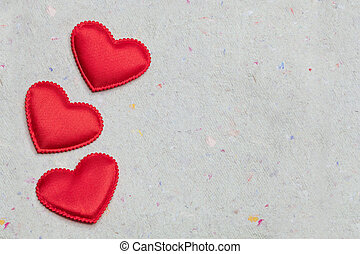 red hearts on vintage paper background