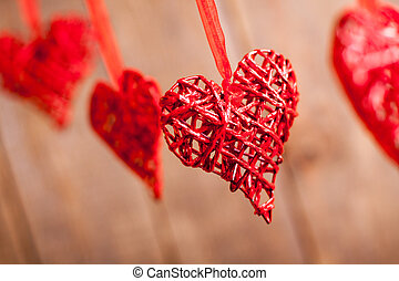 Red hearts on wooden background. Symbol of love in valentine...