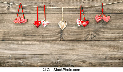 Red hearts on wooden background. Valentines Day