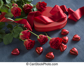 red hearts, ribbon and roses for valentines day