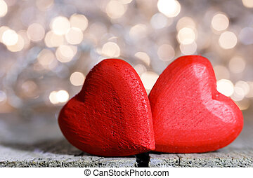 Red hearts symbol of love - Two red wooden hearts symbol of ...