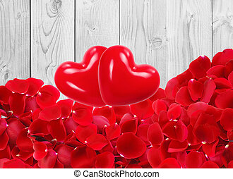 red hearts with beautiful red rose petals on white wooden background