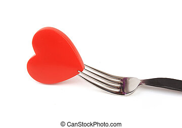 Red hear?with fork on white background