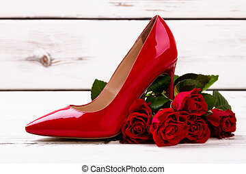 Red heel shoe and roses.