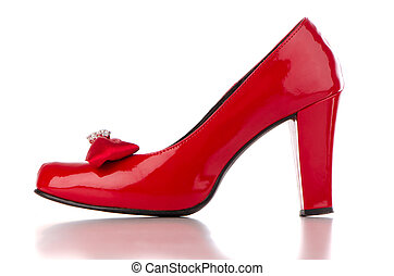 Red high heel women shoe on white reflective background.