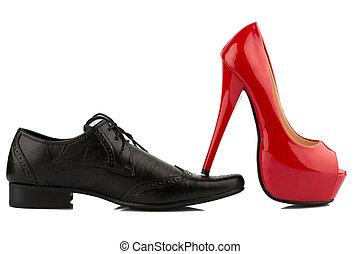 ladies shoe on men's shoe, symbol photo for separation, divorce and conflict