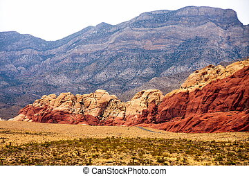Red Hills Between Desert and Purple Mountains