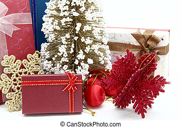 red holiday box with christmas tree and ornament