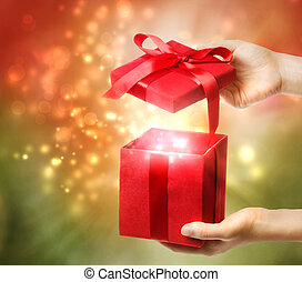 Red Holiday Gift Box - Woman holding a red gift box on a...