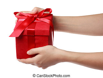 Woman holding a red gift box on a white background