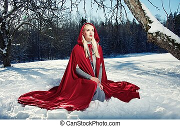 Red Hood sitting on a snow