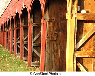 horse shed - red horse shed stalls in a row