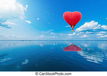 Red hot air balloon in the shape of a heart.