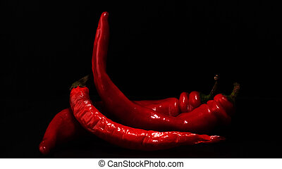 red hot chili peppers on a black background.
