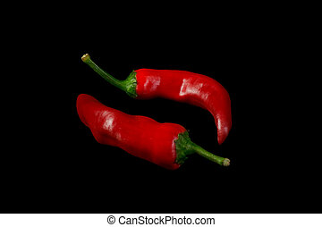 Red hot chili peppers on black background