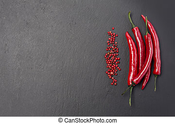 Red hot chili peppers on black