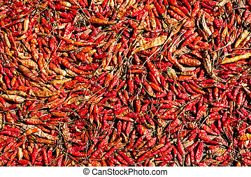 Red hot chilli peppers, top view. Dried in the sun.