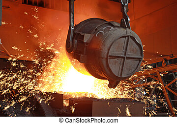 red-hot molten steel in a iron and steel enterprise...