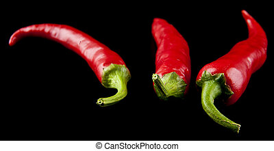 red hot pepper on a black background