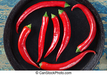 Red hot pepper on a black plate