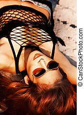 red hot - red hair beautiful woman with sunglasses portrait...